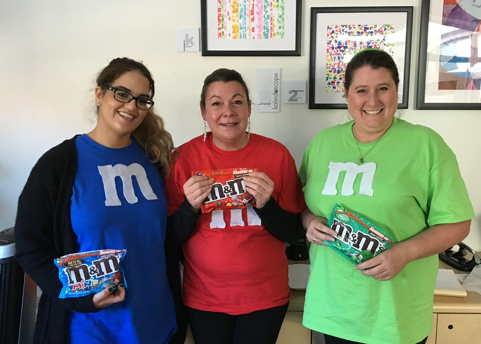 3 staff dressed as M and Ms